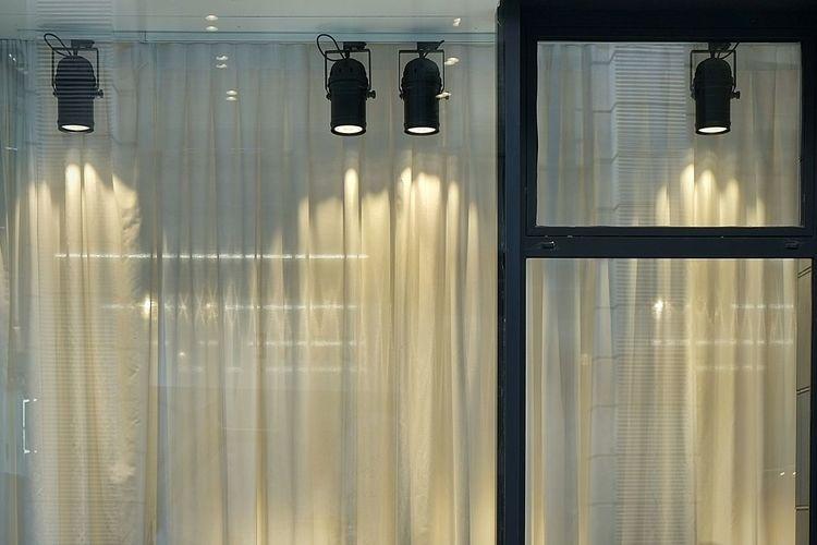 Lights falling on glass window
