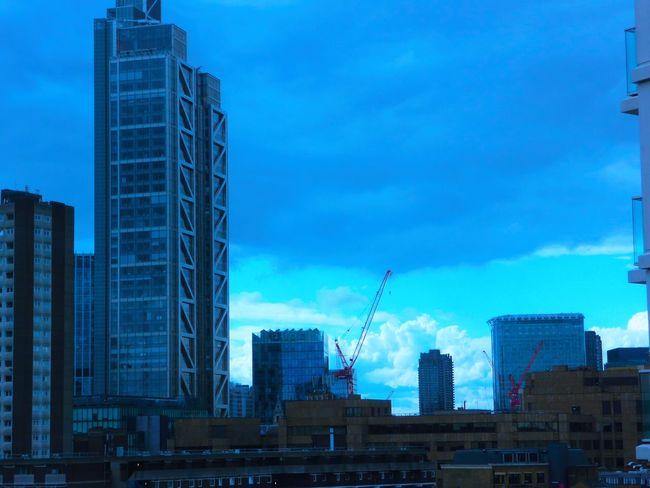 Architecture Blue Building Exterior Building Story Built Structure City Cloud - Sky Construction Construction Site Crane - Construction Machinery Development Downtown District Financial District  Low Angle View Modern Cosmopolitan City Life Office Building Outdoors Skyscraper Tall Tall - High Tower Urban Skyline EyeEmNewHere The Architect - 2017 EyeEm Awards