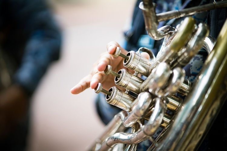Close-up of musician playing horn