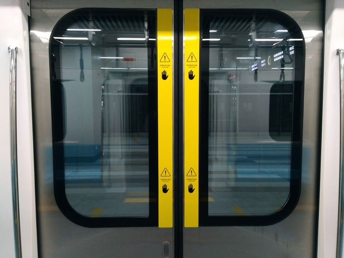 Subway Train Yellow Subway Station Public Transportation Train - Vehicle Window Rail Transportation Door Leaving Journey Commuter Train Passenger Train Vehicle Door Subway Metro Train Train Interior Subway Platform Railroad Station Platform Train Railroad Station
