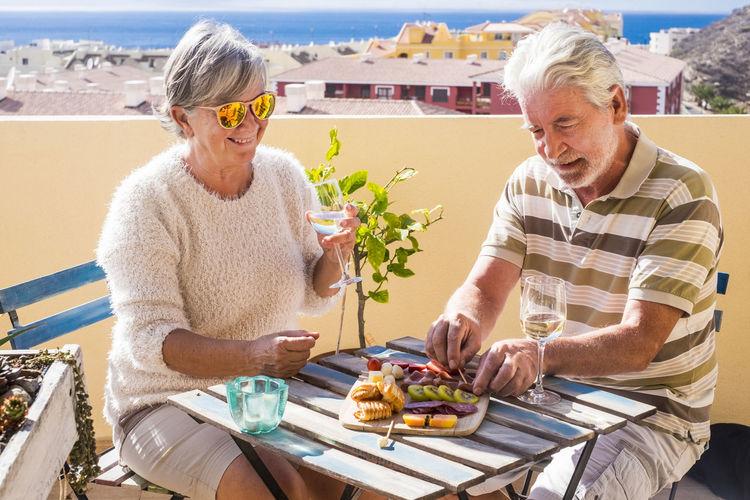 Senior Couple Having Food At Outdoors Restaurant