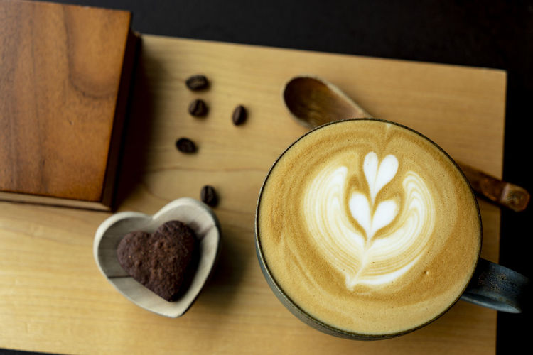latte of the day Cafe Time Addicted Cafe Latte Cream Heart Snack Time! Coffee Beans Wood Plate Drinking Coffee Top View Flat Lay Space For Text