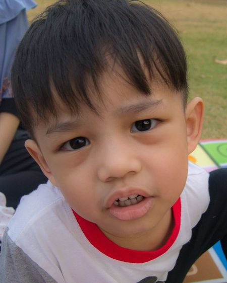 Close-up portrait of cute boy smiling