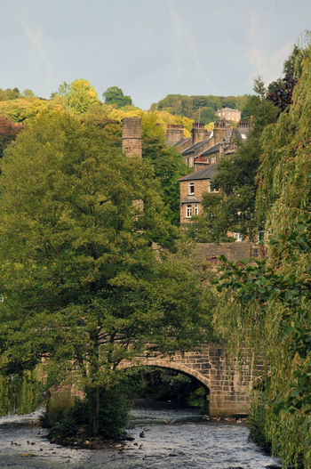 view of hebden bridge from the river calder Hebden Bridge Trees Architecture Bridge Building Exterior Built Structure Day Nature No People Outdoors Sky Town Tree Water