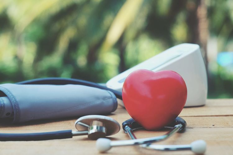 Red heart, stethoscope and blood pressure monitor on table Pressure Pulse Cardiology Cardiac Hospital Help Emergency Accident Illness Healthy Healthcare Sick Care Weakness Insurance Physiotherapy Diagnostic Disease Wellness Medical Health Cure Injury Patient Clinical