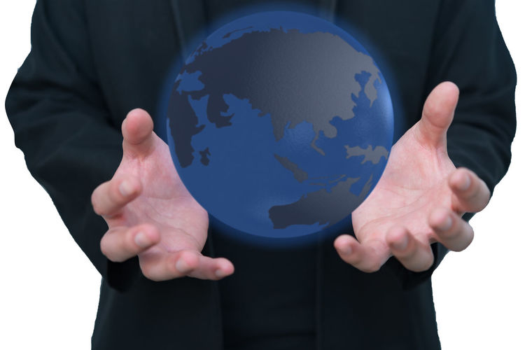 Digital composite image of man standing by globe map against white background
