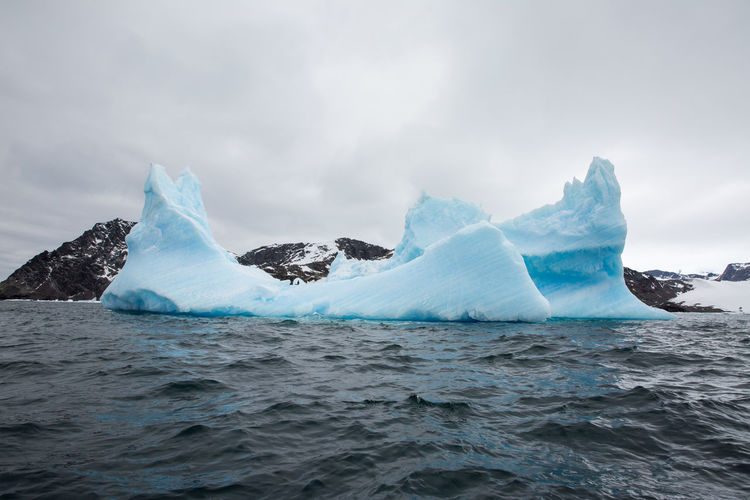 Beauty In Nature Cold Temperature Day Environment Floating On Water Frozen Glacier Ice Iceberg Iceberg - Ice Formation Landscape Melting Nature No People Outdoors Power In Nature Scenics - Nature Sea Sky Tranquil Scene Water Waterfront Winter