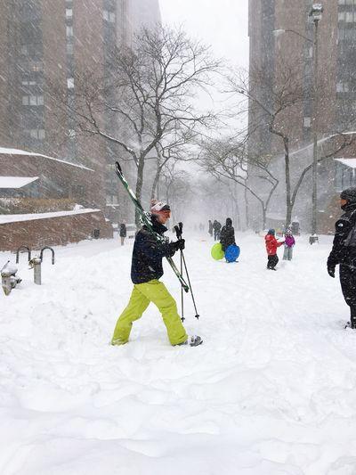 Snow Sports Man Skiing down a Street during a NYC Winter Snowstorm || Snow ❄ Snowing Wintertime Winter Wonderland Winter Sport Ski Crowd Manhattan Upper East Side Manhattan  Snow Sports Snow Sports Snow Sports