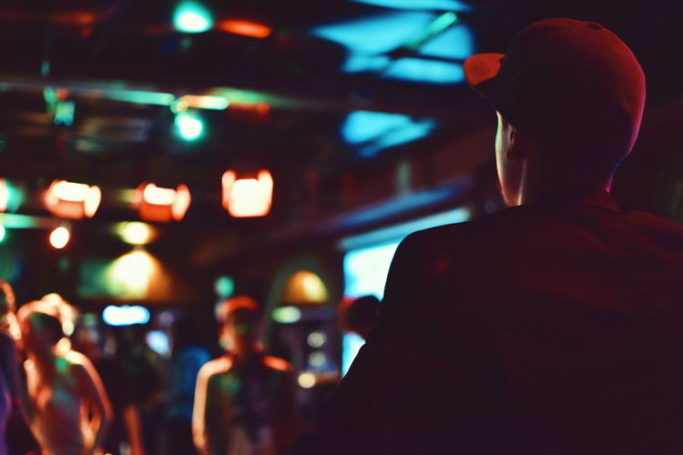 Casual Clothing City City Life Close-up Defocused Focus On Foreground Headshot Illuminated Leisure Activity Lifestyles Night