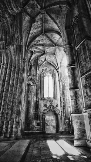The old monastry window Mosteiro Da Batalha Portugal Window Frame Windows Monochrome Black And White EyeEm Selects Place Of Worship Spirituality Religion Arch Architecture Built Structure Passageway Historic Historic Building Archway The Past Architectural Column Building Abbey History Interior Arched Entry Passage