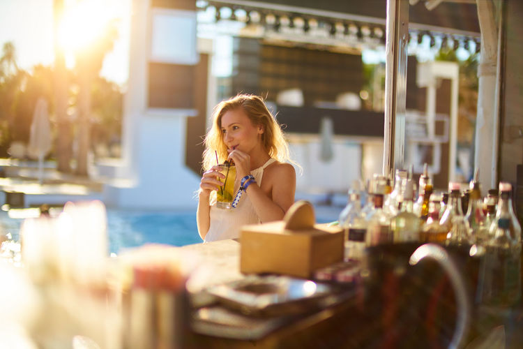 Adult Bar Beautiful Woman Casual Clothing Day Eating Food Food And Drink Freshness Holding Indoors  Leisure Activity Lifestyles One Person One Young Woman Only People Real People Selective Focus Sunlight Young Adult Young Women