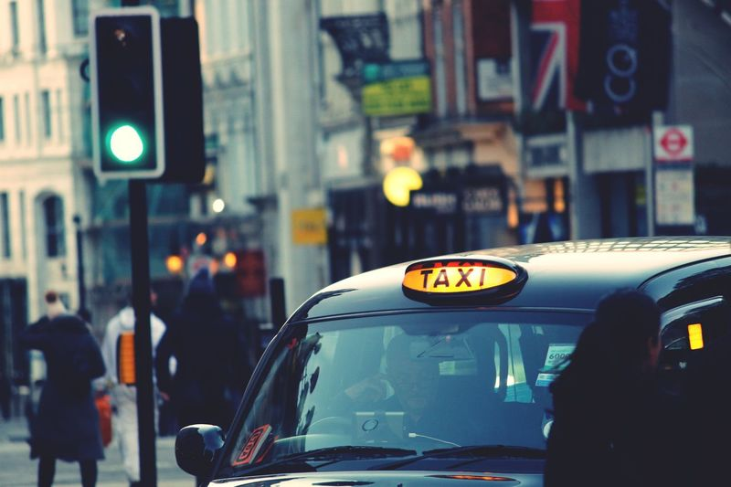 The iconic black cabs of London. A bit expensive, bur priceless experiment. Car Street Transportation City Mode Of Transport Illuminated Traffic City Street Land Vehicle City Life Night Outdoors Architecture Yellow Taxi Built Structure Real People Building Exterior One Person People EyeEmNewHere Be. Ready.