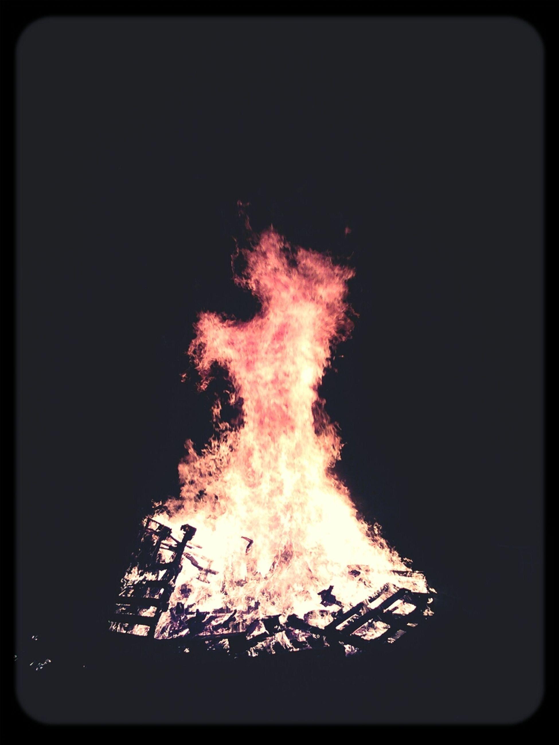 burning, flame, fire - natural phenomenon, heat - temperature, night, glowing, transfer print, bonfire, dark, fire, illuminated, copy space, auto post production filter, close-up, black background, light - natural phenomenon, firewood, heat, campfire, motion