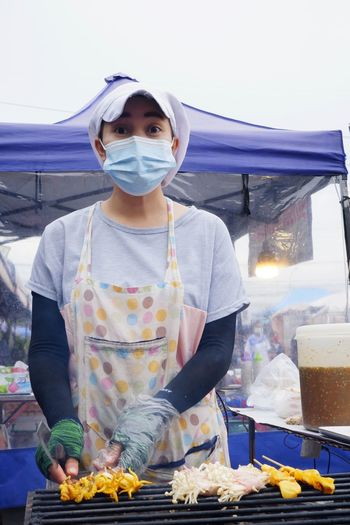 Woman holding ice cream at market