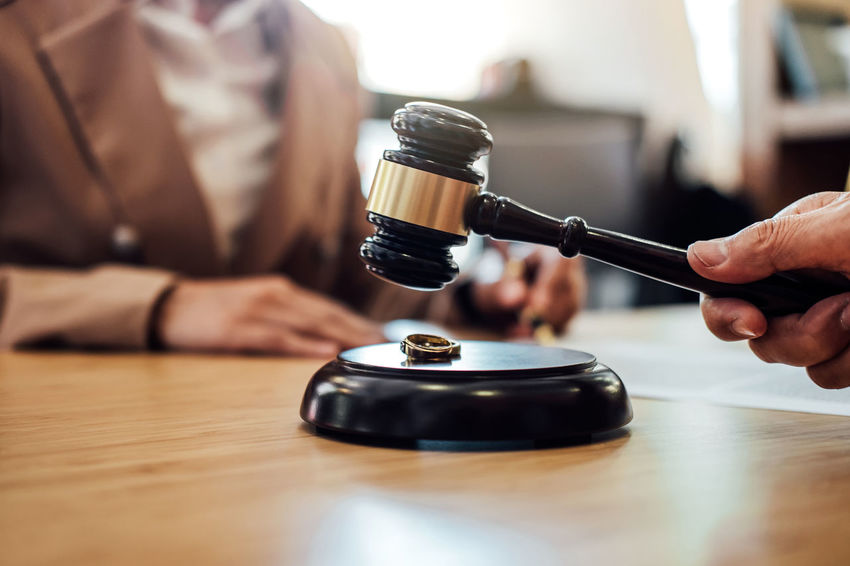 Divorce Lawyer Adult Barrister Body Part Close-up Conflict Consultant Counselor Fairness Gavel Hand Holding Human Hand Indoors  Judge Judgement Justice Legal Men Occupation One Person Selective Focus Verdict Wood - Material