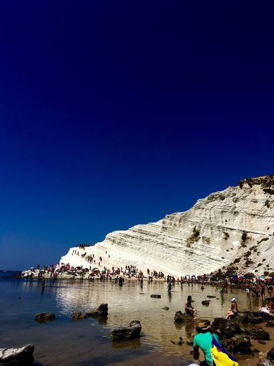 Scala dei turchi Blue Clear Sky Copy Space Beach Mountain Water Go Higher Nature Large Group Of People Beauty In Nature Outdoors Sunlight Scenics Sand Sky Nautical Vessel Day Vacations Sea People