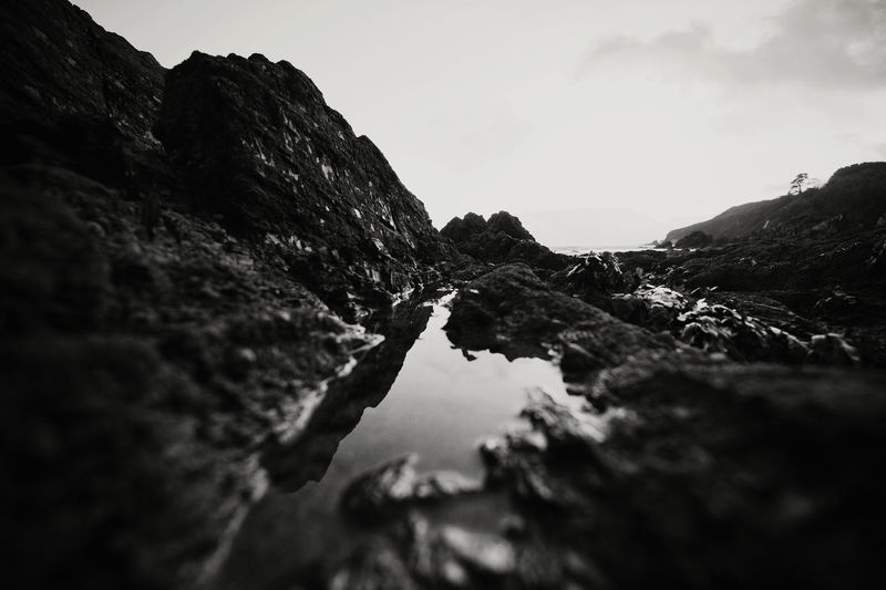 Depth Of Field Geology Monochrome Non-urban Scene Outdoors Reflection Remote Rock Rockpool Rough Sea Seaside Selective Focus Tranquil Scene Water Weather