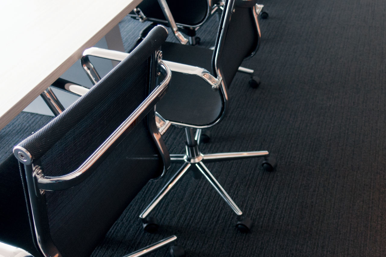 High Angle View Of Chairs By Table At Conference Room