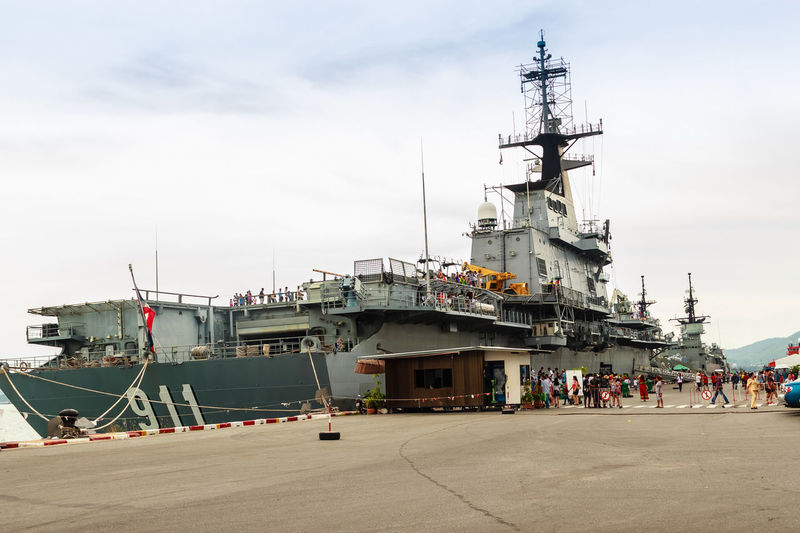 Sattahip, Chonburi, Thailand - May 3, 2015: HTMS Chakri Naruebet aircraft carrier was shown for Thai people and tourist to visit at Sattahip Naval Base, Chonburi, Thailand. Battle Ship Chakri Naruebet Naruebet Aircraft Carrier Architecture Battle Battleship Building Exterior Built Structure Chakri Day Htms Large Group Of People Nautical Vessel Outdoors People Place Of Worship Sattahip Sattahip Naval Base Sky Transportation Travel Destinations