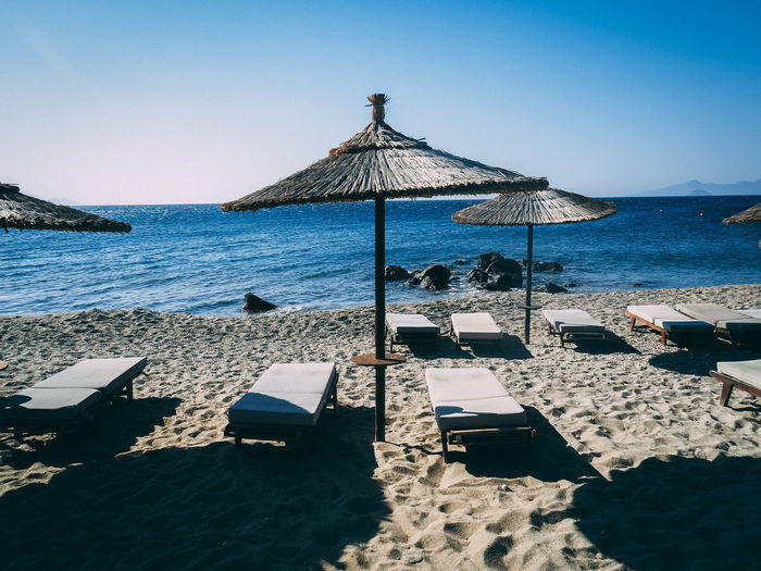 Beach Beauty In Nature Chair Clear Sky Horizon Horizon Over Water Land Nature No People Outdoors Parasol Scenics - Nature Sea Shade Sky Sunlight Swimming Pool Thatched Roof Tranquil Scene Tranquility Umbrella Water