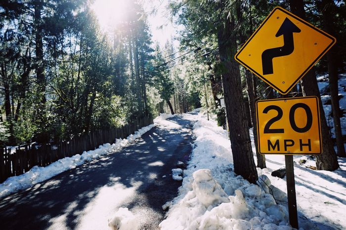 Winter roads Snow Cold Temperature Winter Road Sign Sunlight Day Nature Speed Limit Sign