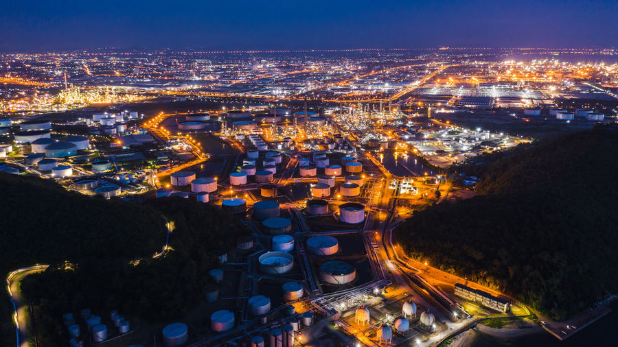 Aerial view of petrochemical plant in city at night