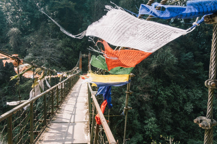 View of footbridge hanging on mountain