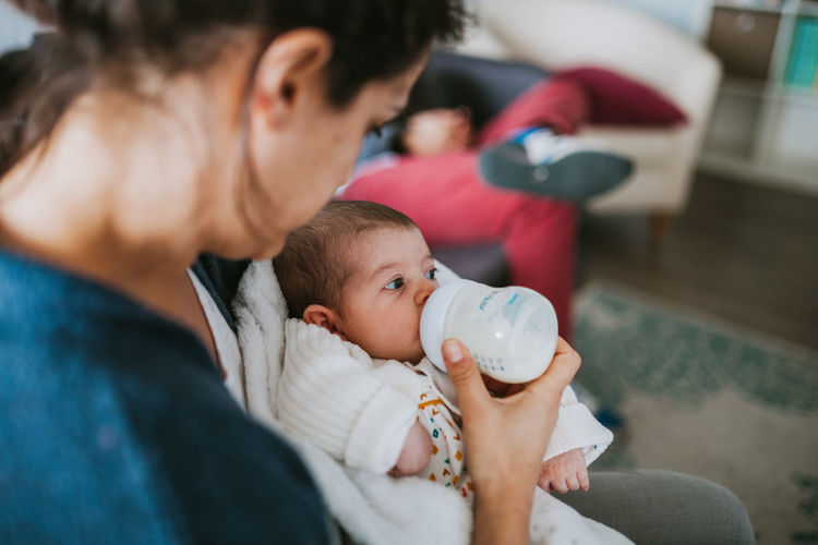 Bottle Eating Family With One Child Family Matters Milk Daughter Positive Emotion Care Togetherness Cute Son Adult Innocence Females Women Real People Indoors  Mother Childhood Child Baby Young Parent Family Babyhood International Women's Day 2019