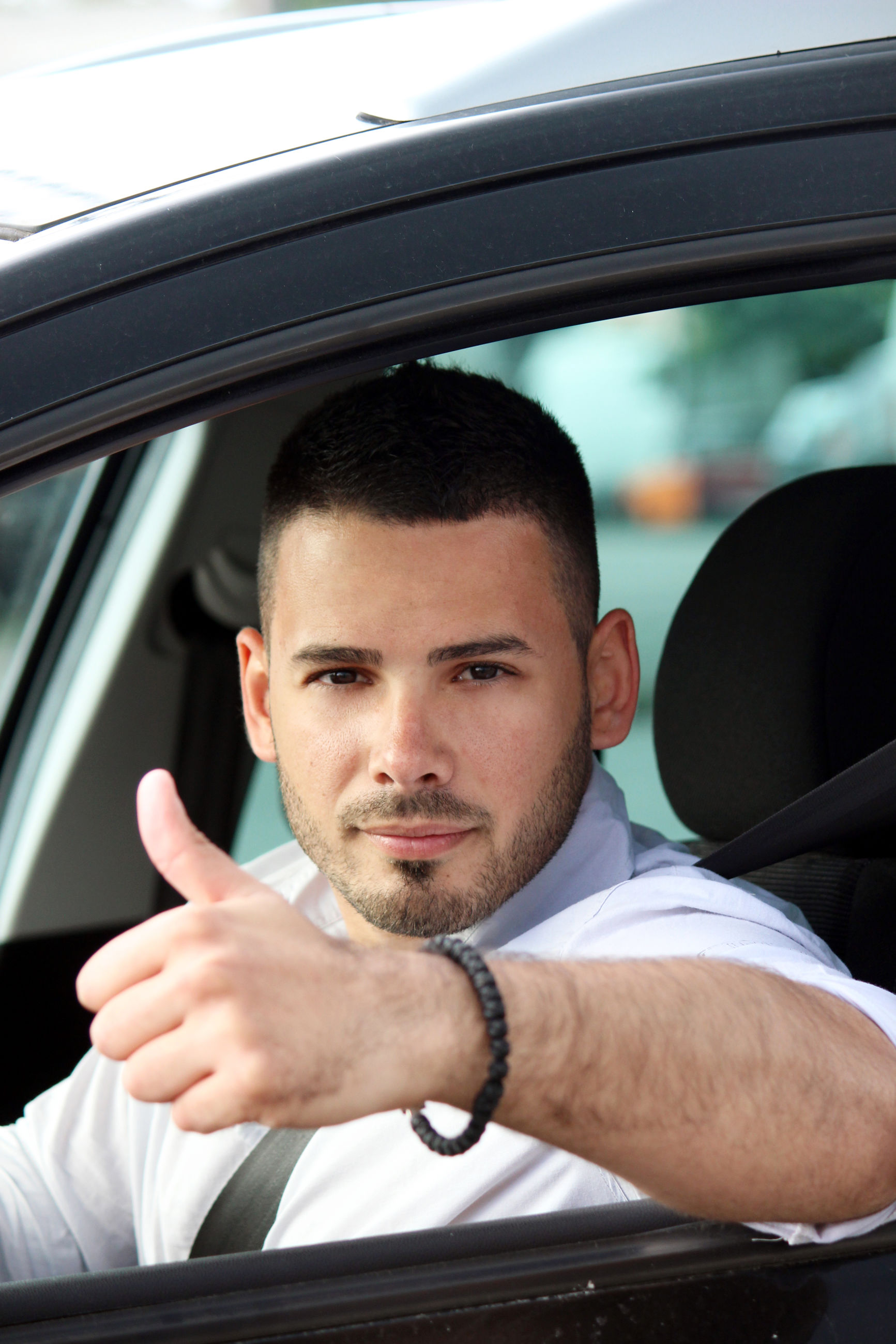 PORTRAIT OF YOUNG MAN WITH CAR