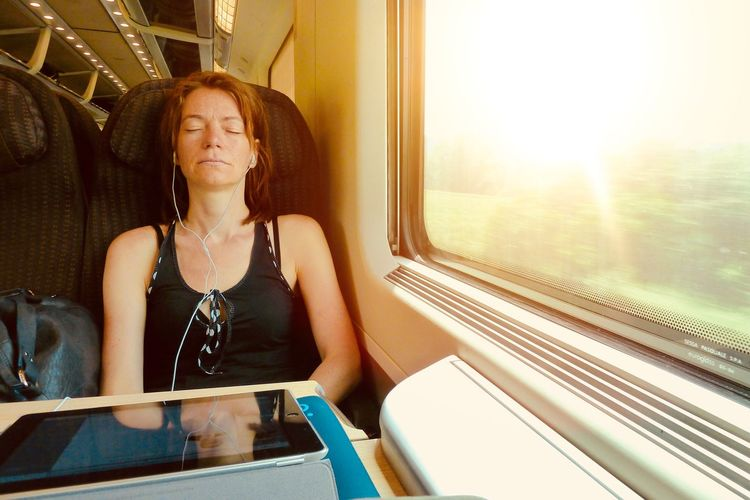 Listening To Music Listening Train Travel Window Sitting Indoors  One Person Looking Through Window Train - Vehicle Young Adult Real People One Woman Only Young Women Vehicle Seat Lifestyles Beautiful Woman Adult Portrait Only Women People
