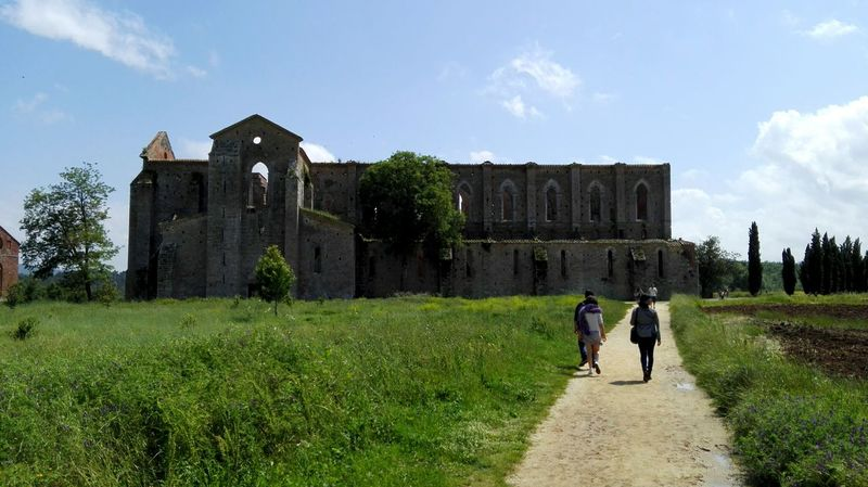 Architecture Built Structure Rear View Tuscanygram Walking Tuscany Building Exterior Sky Person Surface Level Tourism Tourist Day The Way Forward History Outdoors Lawn Footpath Pathway Culture Sangalgano Sangalganoabbey Abbey Ruins Magical Places Famous Place