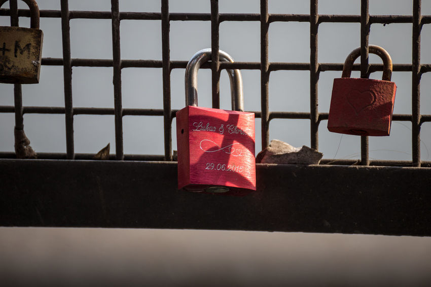 Close-up Day Hanging Hope Lock Love Love Lock Metal No People Outdoors Padlock Protection Railing Red Safety Security Symbol Of Love Water