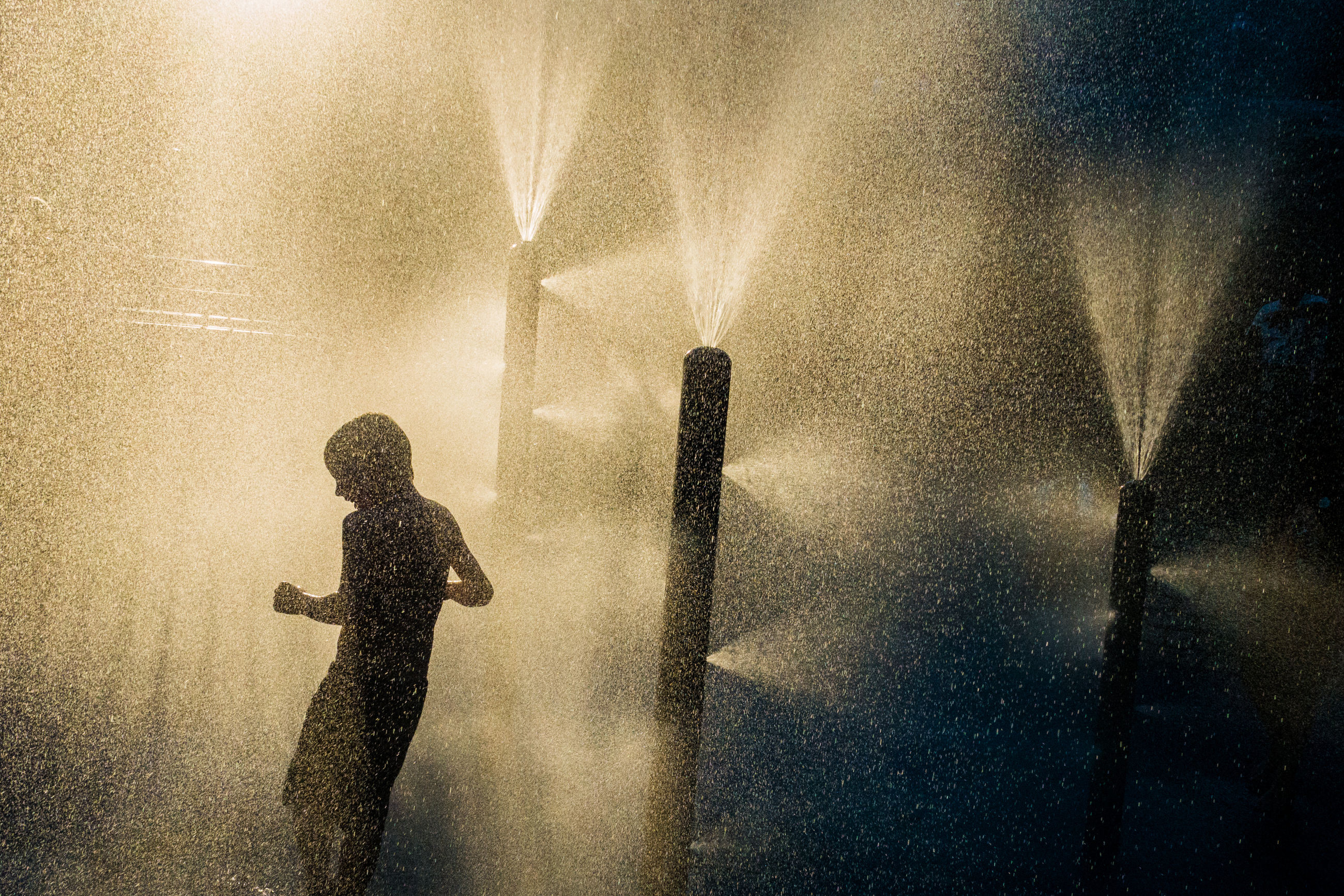 spraying, night, standing, silhouette, three quarter length, water, motion, mobile phone, one person, wireless technology, long exposure, outdoors, adult, people, adults only, technology, one man only, young adult, sky, pixelated