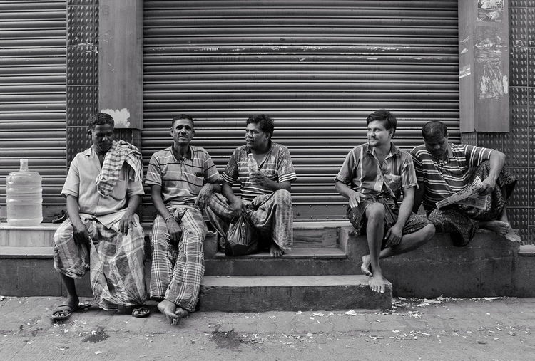 Group of people sitting outside building