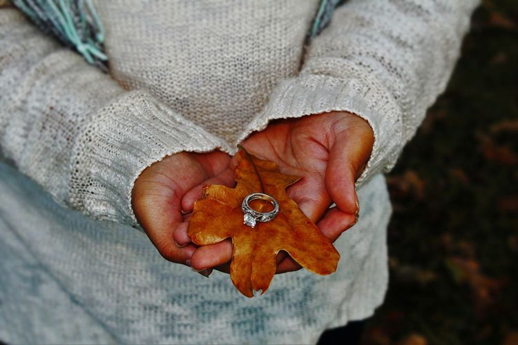 Midsection Of Woman Holding Ring During Autumn