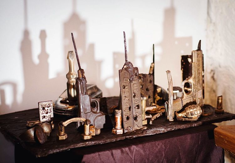 Various Objects On Table With Shadow Of City In Chocolate Museum