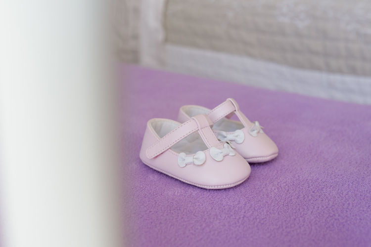 Tiny baby shoes for christening day Baby Bows Babygirl Babyhood Celebration Event Christening Day Close-up Emotion No People Pair Pink Color Purple Ribbon Sandal Selective Focus Shoe Still Life Textile White Color