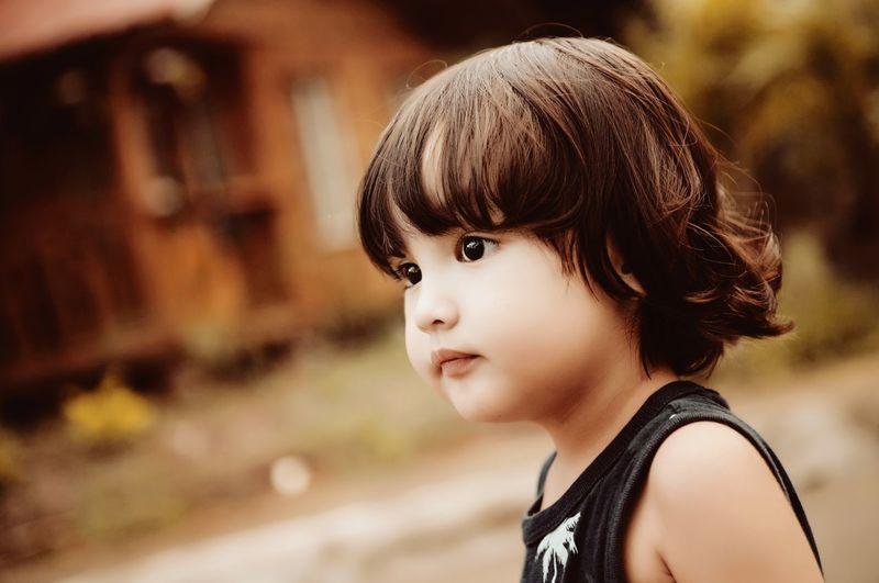 Asian boy looking away