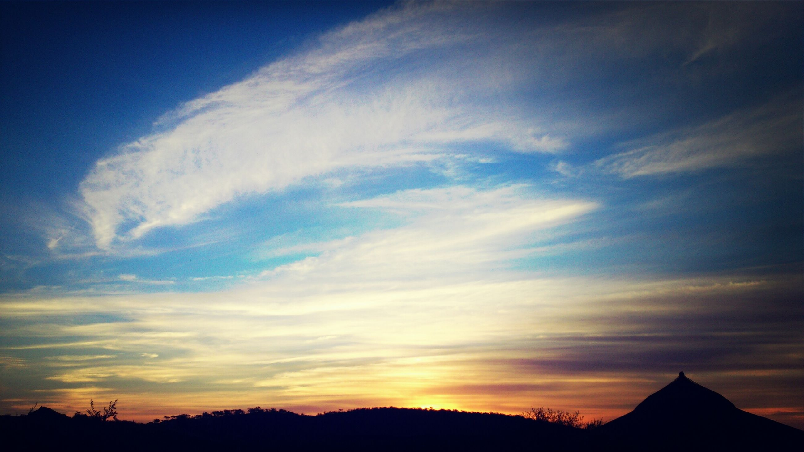 silhouette, sky, sunset, beauty in nature, scenics, tranquil scene, tranquility, nature, cloud - sky, low angle view, cloud, idyllic, mountain, dusk, outdoors, landscape, blue, majestic, no people, tree