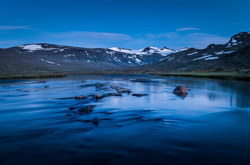 River in the Jotunheimen mountain area, summer time. EyeEmNewHere Glacier Rural Wilderness Travel Outdoors Twilight Tranquil Summer Night Hiking River Flowing River Scenics Beautiful Norway Jotunheimen Nature Blue Tranquil Scene Snow Cold Temperature Beauty In Nature Water Scenics - Nature Mountain