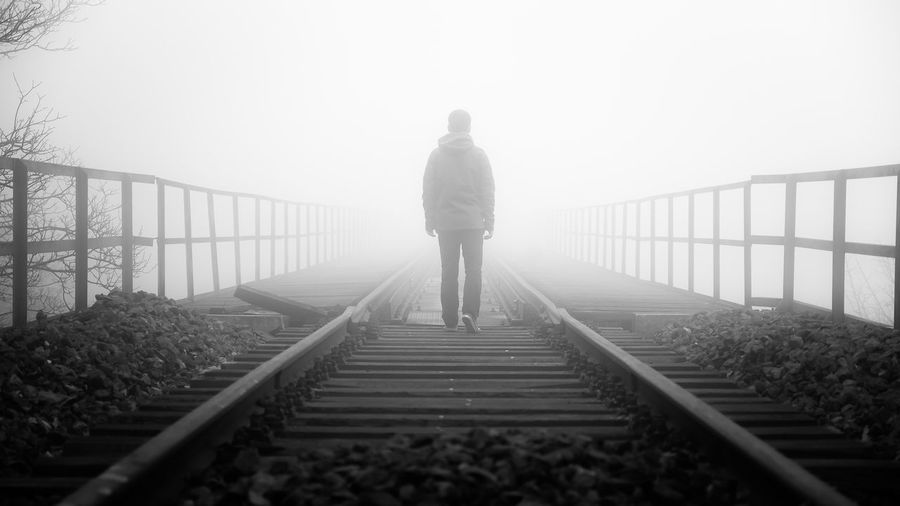 EyeEmNewHere Adult Adults Only Bridge - Man Made Structure Day Exercising Fog Footbridge Full Length Lifestyles Men One Man Only One Person Only Men Outdoors People Railing Railroad Track Real People Rear View Silhouette Sky Standing Walking