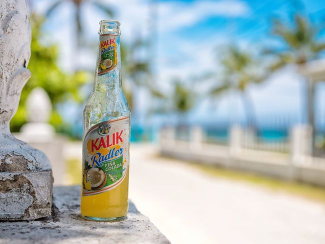 A refreshing summer 🍹 Focus On Foreground No People Close-up Outdoors Day Sky Alcoholic Drink Kalik Piña Colada Photographyisthemuse Fujifilm Gfx 50s The Bahamas Tropical Paradise Color Photography