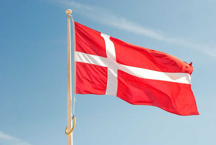 Low angle view of danish flag against sky