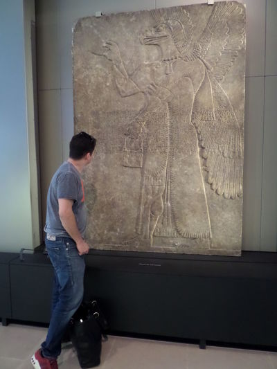 Ancient Art. Art. Casual Clothing Full Length Leisure Activity Lifestyles Male Person. Museum. One Person. One Personality. One Heart Sculpture. Viewer.