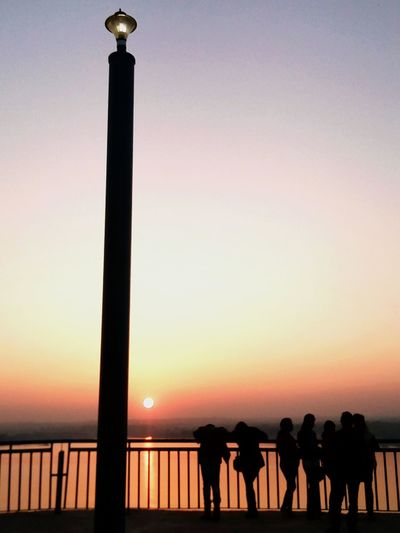 People Standing Watching The Sunset EyeEmNewHere Colour Your Horizn