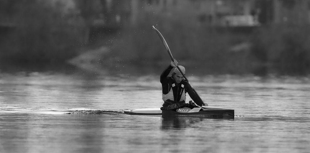Man on boat in lake