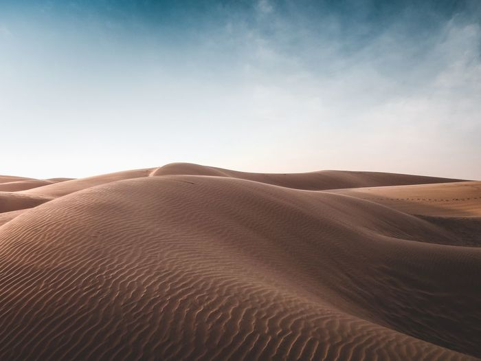 Sand dunes in the desert during the day