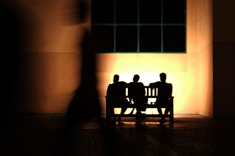 Men sits