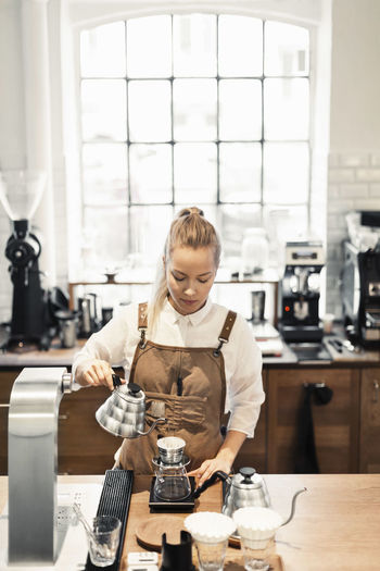 Woman holding coffee in cafe