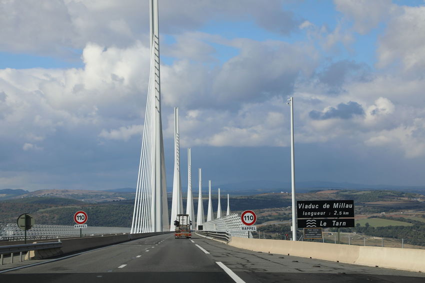 Viaduc De Millau Architecture Bridge - Man Made Structure Built Structure Car Cloud - Sky Connection Day Highway Land Vehicle Mountain Nature No People Outdoors Road Road Marking Sky The Way Forward Transportation